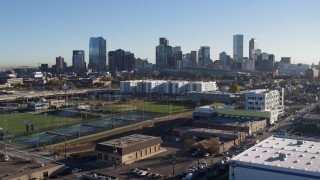 DX0001_001643 - 5.7K stock footage aerial video reverse view of the city skyline at sunrise, seen during descent in Downtown Denver, Colorado