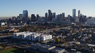 DX0001_001644 - 5.7K stock footage aerial video ascend to reveal the city skyline at sunrise in Downtown Denver, Colorado