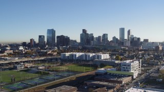 DX0001_001645 - 5.7K stock footage aerial video reverse view of the city skyline at sunrise before descent in Downtown Denver, Colorado