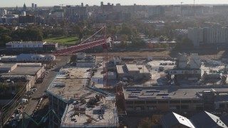 DX0001_001650 - 5.7K stock footage aerial video orbit a crane atop a building under construction at sunrise in Downtown Denver, Colorado