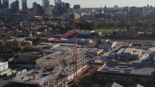 DX0001_001651 - 5.7K stock footage aerial video circle a crane atop a building under construction at sunrise in Downtown Denver, Colorado