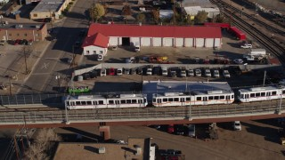 DX0001_001652 - 5.7K stock footage aerial video track commuter train at sunrise in Downtown Denver, Colorado