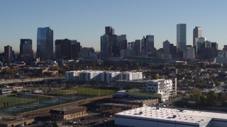 DX0001_001655 - 5.7K stock footage aerial video flyby and ascend the city's skyline at sunrise in Downtown Denver, Colorado
