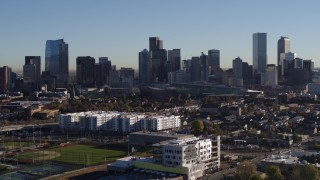 DX0001_001656 - 5.7K stock footage aerial video approach and flyby the city's skyline at sunrise in Downtown Denver, Colorado