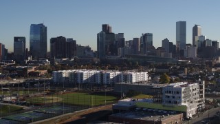 DX0001_001657 - 5.7K stock footage aerial video of the city's skyline at sunrise while descending in Downtown Denver, Colorado