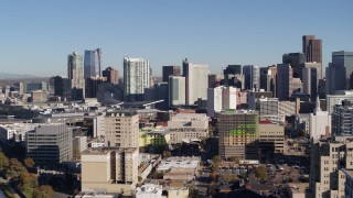 DX0001_001661 - 5.7K stock footage aerial video reverse and flyby the city's skyline, seen from office buildings in Downtown Denver, Colorado