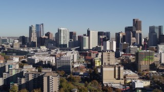DX0001_001662 - 5.7K stock footage aerial video flyby the city's skyline, seen from office and apartment buildings in Downtown Denver, Colorado