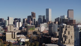 DX0001_001666 - 5.7K stock footage aerial video of the city's skyline, seen from office buildings before descent in Downtown Denver, Colorado