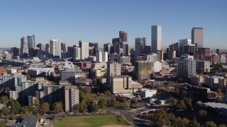DX0001_001667 - 5.7K stock footage aerial video static view the city's skyline, before passing office and apartment buildings in Downtown Denver, Colorado