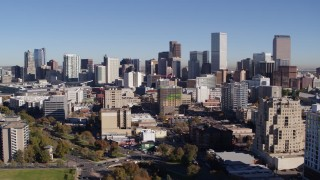 DX0001_001669 - 5.7K stock footage aerial video of the city's skyline, while passing office and apartment buildings in foreground, Downtown Denver, Colorado