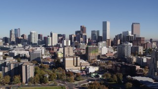 DX0001_001670 - 5.7K stock footage aerial video of the city's skyline, flyby office and apartment buildings in foreground, Downtown Denver, Colorado
