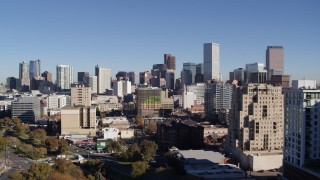 DX0001_001674 - 5.7K stock footage aerial video ascend from park to approach the city's skyline, Downtown Denver, Colorado