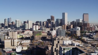 DX0001_001675 - 5.7K stock footage aerial video flyby and away from the city's skyline, seen from office buildings, Downtown Denver, Colorado