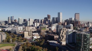 DX0001_001676 - 5.7K stock footage aerial video of the city's skyline behind apartment and office buildings, Downtown Denver, Colorado