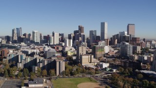DX0001_001677 - 5.7K stock footage aerial video of flyby the city's skyline descend behind office buildings, Downtown Denver, Colorado