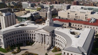 DX0001_001696 - 5.7K stock footage aerial video descend while passing the Denver City Council building, Downtown Denver, Colorado