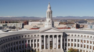 DX0001_001697 - 5.7K stock footage aerial video ascend with view of top of the Denver City Council building, Downtown Denver, Colorado