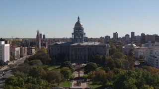 DX0001_001700 - 5.7K stock footage aerial video ascend from park while focusing on Colorado State Capitol, Downtown Denver, Colorado