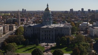 DX0001_001713 - 5.7K stock footage aerial video fly away from the Colorado State Capitol during descent, Downtown Denver, Colorado