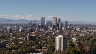 DX0001_001723 - 5.7K stock footage aerial video of the city's skyline with mountains in the background, seen during ascent, Downtown Denver, Colorado