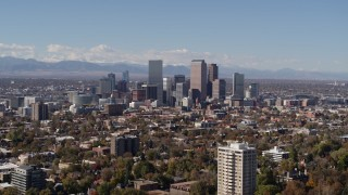 DX0001_001728 - 5.7K stock footage aerial video of wide view of the city's skyline, mountains in distance, Downtown Denver, Colorado