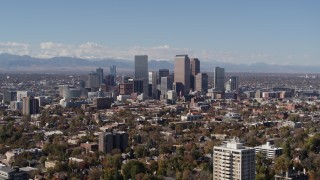 DX0001_001729 - 5.7K stock footage aerial video of slow approach to the city's skyline, mountains in distance, Downtown Denver, Colorado