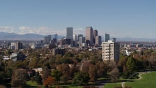 DX0001_001730 - 5.7K stock footage aerial video of the city's skyline, mountains in distance, seen while descending, Downtown Denver, Colorado
