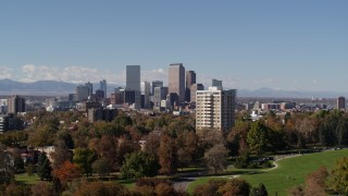 DX0001_001731 - 5.7K stock footage aerial video of the city's skyline, seen from park with trees, Downtown Denver, Colorado