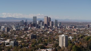 DX0001_001733 - 5.7K stock footage aerial video wider view of the city's skyline, with the mountains in background, Downtown Denver, Colorado