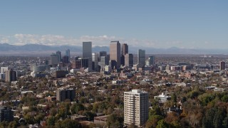 DX0001_001734 - 5.7K stock footage aerial video flying by the city's skyline, with the mountains in background, Downtown Denver, Colorado