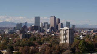 DX0001_001737 - 5.7K stock footage aerial video pass the city's skyline before ascending, Downtown Denver, Colorado