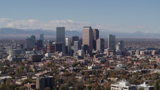 DX0001_001742 - 5.7K stock footage aerial video slow ascent by the city's skyline with mountains in distance, Downtown Denver, Colorado