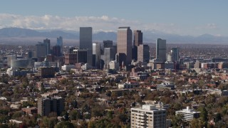 DX0001_001745 - 5.7K stock footage aerial video of focusing on the city's skyline with mountains in distance, Downtown Denver, Colorado