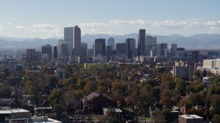 DX0001_001752 - 5.7K stock footage aerial video of a stationary view of the city's skyline with Rockies in the background, Downtown Denver, Colorado