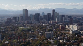 DX0001_001753 - 5.7K stock footage aerial video of flying by the city's skyline with Rockies in the background, Downtown Denver, Colorado