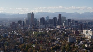 DX0001_001755 - 5.7K stock footage aerial video of flying by the city's skyline with Rockies in the background during ascent, Downtown Denver, Colorado