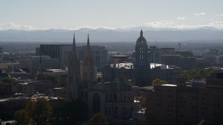 DX0001_001757 - 5.7K stock footage aerial video of the Colorado State Capitol seen while passing cathedral, Downtown Denver, Colorado