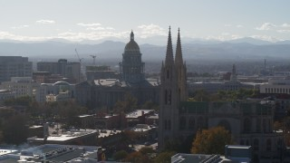 DX0001_001762 - 5.7K stock footage aerial video of the Colorado State Capitol and a nearby cathedral, Downtown Denver, Colorado