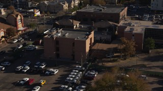 DX0001_001770 - 5.7K stock footage aerial video flyby and approach a brick police station in Denver, Colorado