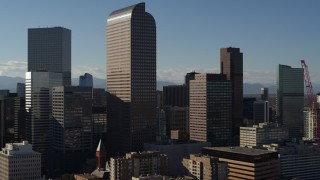 DX0001_001776 - 5.7K stock footage aerial video descend and flyby Wells Fargo Center and nearby skyscrapers in Downtown Denver, Colorado