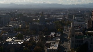 DX0001_001780 - 5.7K stock footage aerial video of Colorado State Capitol, Denver City Council and cathedral while descending in Downtown Denver, Colorado