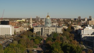 DX0001_001783 - 5.7K stock footage aerial video of flying by Colorado State Capitol and tree-lined park in Downtown Denver, Colorado