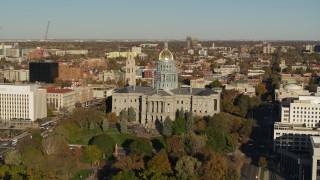 DX0001_001785 - 5.7K stock footage aerial video of slowly passing by Colorado State Capitol and tree-lined park in Downtown Denver, Colorado