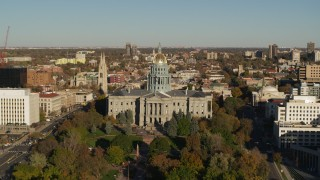 DX0001_001787 - 5.7K stock footage aerial video slowly ascend to view the Colorado State Capitol and tree-lined park in Downtown Denver, Colorado