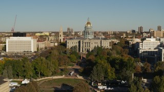 DX0001_001792 - 5.7K stock footage aerial video focus on the Colorado State Capitol during short descent in Downtown Denver, Colorado