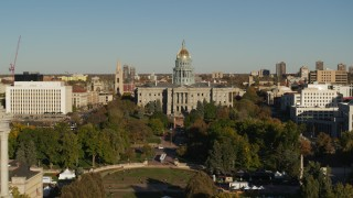 DX0001_001794 - 5.7K stock footage aerial video of the Colorado State Capitol, reveal clock tower in Downtown Denver, Colorado