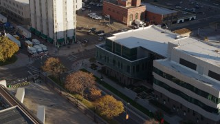 DX0001_001802 - 5.7K stock footage aerial video approach a police crime lab and descend in Downtown Denver, Colorado