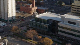 DX0001_001803 - 5.7K stock footage aerial video of orbiting the side of a police crime lab and descend in Downtown Denver, Colorado