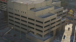 DX0001_001806 - 5.7K stock footage aerial video of an orbit of the side of a police station in Downtown Denver, Colorado