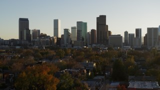 DX0001_001807 - 5.7K stock footage aerial video ascend for view of skyline at sunset in Downtown Denver, Colorado
